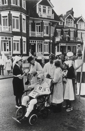 Men and women in hospital fancy dress, collecting money for charity, 1968.