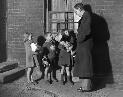 Children holding Christmas presents outside