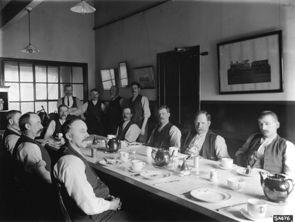 The dining room in the enginemen's hostel at Stratford, East London, c 1911.