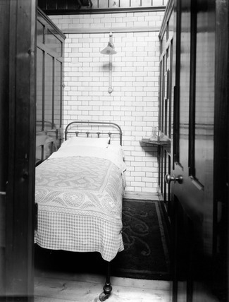 Cubicle in the enginemen's dormitory at Stratford in East London, c 1911.
