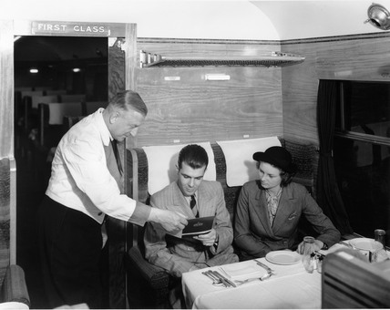Serving passengers in a LMS dining car, c 1937.