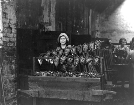 Kipper girl displaying smoked kippers.