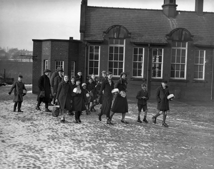 Children leave their school in Disley, Ches