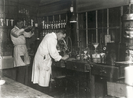 Two scientists at work in a laboratory, c 1930s.