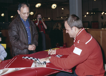 Rubens Barrichello, Brazilian racing driver, signing autographs, 2002.