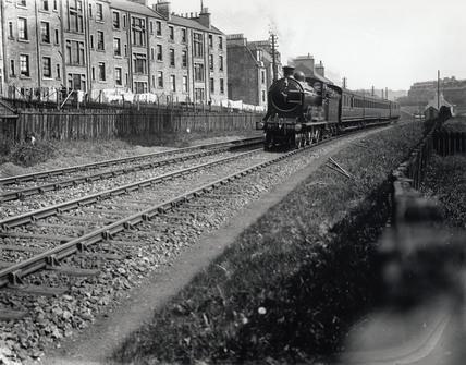 A North British Railway local passenger train, near Hawick, Border, c 1910.