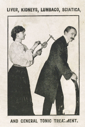Using the 'Veedee' vibratory massager, c 1900-1925.