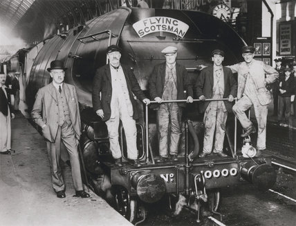 Sir Nigel Gresley with railwaymen beside locomotive No 10,000, 1930.