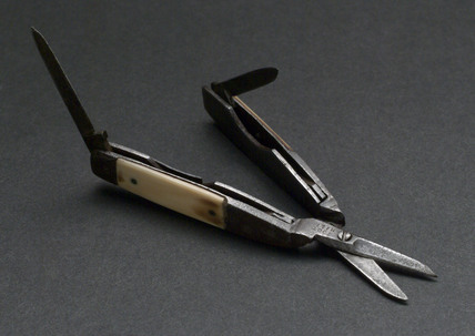 Pair of small scissors with folding knife blades. 19th century.