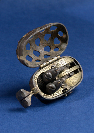 Tinder pistol in egg-shaped case, Japanese, 1700-1850.