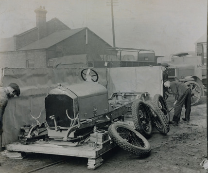 Napier car engine and chassis preparing for shipping at the docks