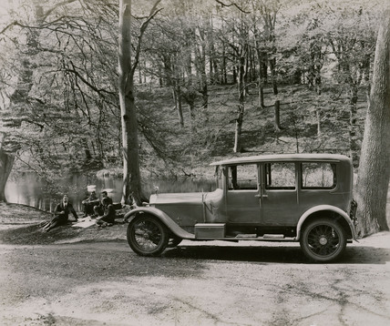 Napier saloon in woodland scene side view