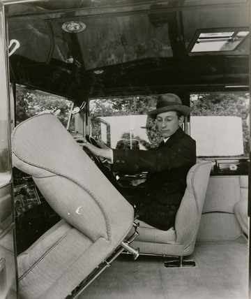 [Short chassis saloon car?] Interior shot with driver showing tipping front seat