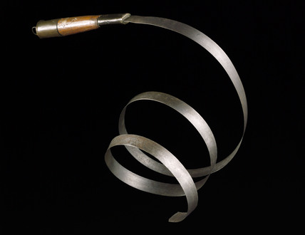 Spring steel slave whip, 19th century.