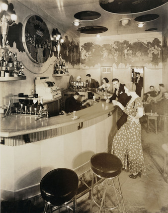 Drinking in the 'Nickerbocker' bar on the 'Empress of Britain', c 1934.