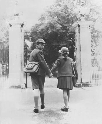 Two school children walking hand in hand, 26 August 1960.
