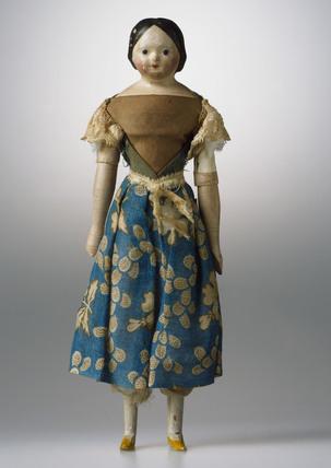 Papier mAchE doll, c 1840.