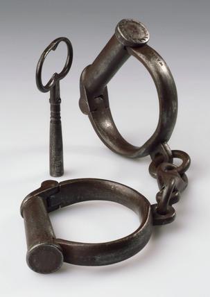 Pair of iron handcuffs, 19th century.