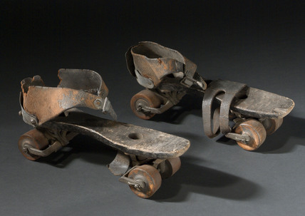 Pair of wooden roller skates, c 1880.