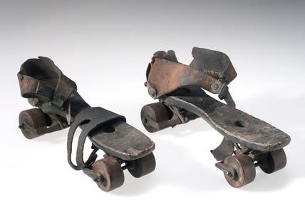 Pair of wooden roller skates, c 1880.