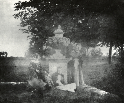 Women women and a man by urn in garden, c 1840.
