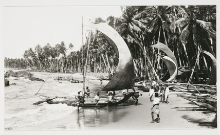 Boats on a tropical beach, c 1925.