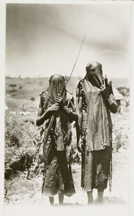 Two masked hunters, c 1925.