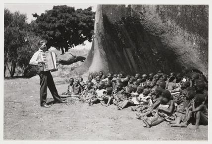 Accordion player, Africa, c 1925.