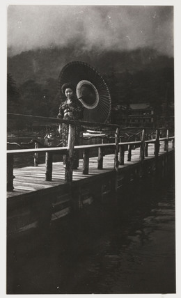 Japanese woman on a bridge, c 1925.