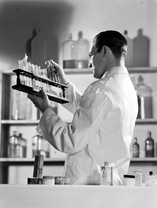 Chemist working in a laboratory, 1949.