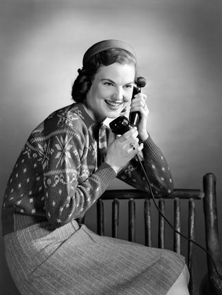 Woman talking on the telephone, c 1950.