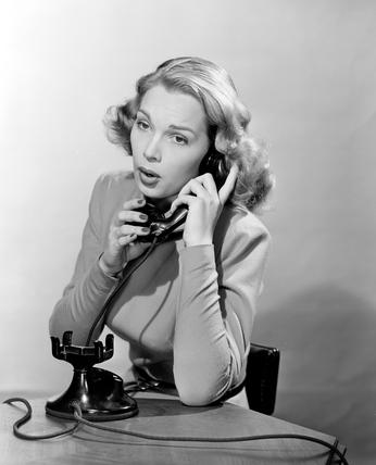 Women answering the telephone, c 1948.