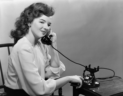 Woman using the telephone, c 1950.