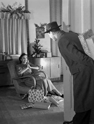 Man bringing Christmas presents, c 1949.