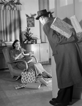 Man bringing Christmas presents, c 1949.