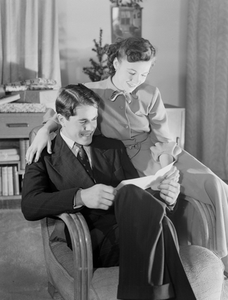 Couple reading, c 1949.