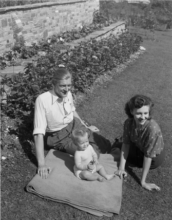 Young family in a garden, 1948.