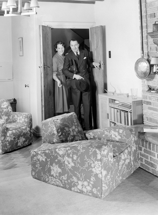 Couple entering a room, c 1950.