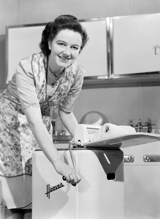 Woman operating a Hoover washing machine and wringer, c 1948.