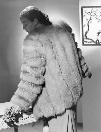Woman wearing fur coat, c 1950.