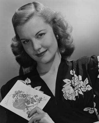 Portrait of a woman holding Valentine's card, 1949