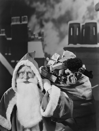 Father Christmas on a snowy roof top, 1950.
