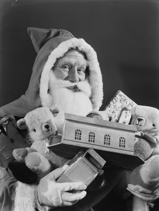 Father Christmas carrying toys, 1950.