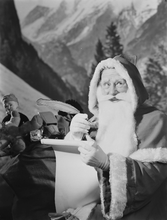 Father Christmas checking his list, 1950.