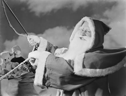 Father Christmas in a sleigh, 1950.