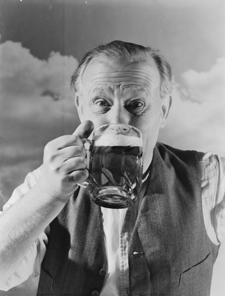Man drinking a pint of beer, 1952.