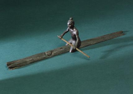 Man paddling a log, 1931.