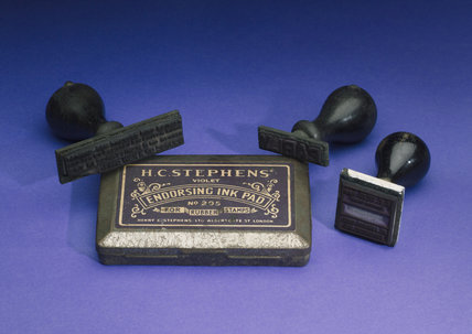 Three rubber stamps and ink pad, early 20th century.