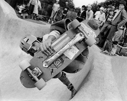 Skateboarder pulling off a trick at a skate park, 20 November 1978.