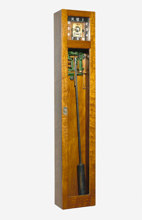 Electrically-driven pendulum clock.